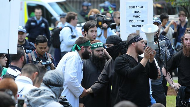 204233-a-rioter-smashes-a-police-window-in-the-islamic-riots-in-sydney-cbd