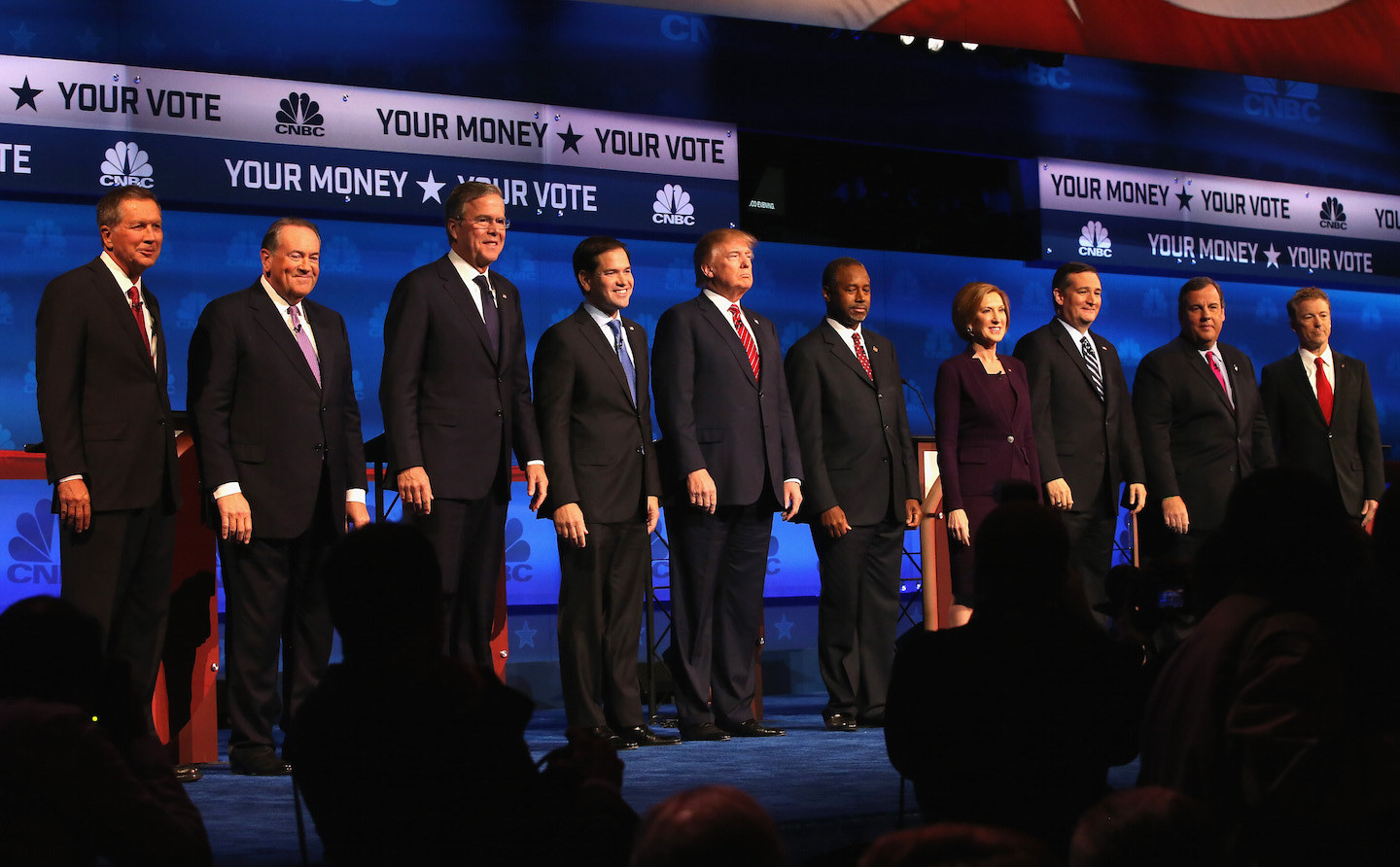 BOULDER, CO - OCTOBER 28: Presidential candidates Ohio Governor John Kasich (L-R), Mike Huckabee, Jeb Bush, Sen. Marco Rubio (R-FL), Donald Trump, Ben Carson, Carly Fiorina, Ted Cruz (R-TX), New Jersey Governor Chris Christie, and Sen. Rand Paul (R-KY) take the stage at the CNBC Republican Presidential Debate at University of Colorados Coors Events Center October 28, 2015 in Boulder, Colorado. Fourteen Republican presidential candidates are participating in the third set of Republican presidential debates. (Photo by Justin Sullivan/Getty Images)