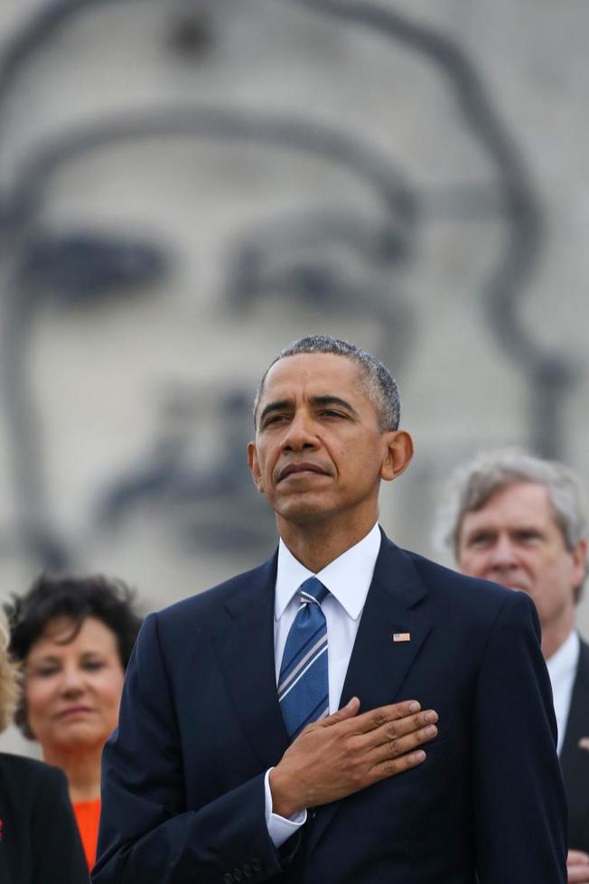 Obama In Cuba with Che Guevara Behind