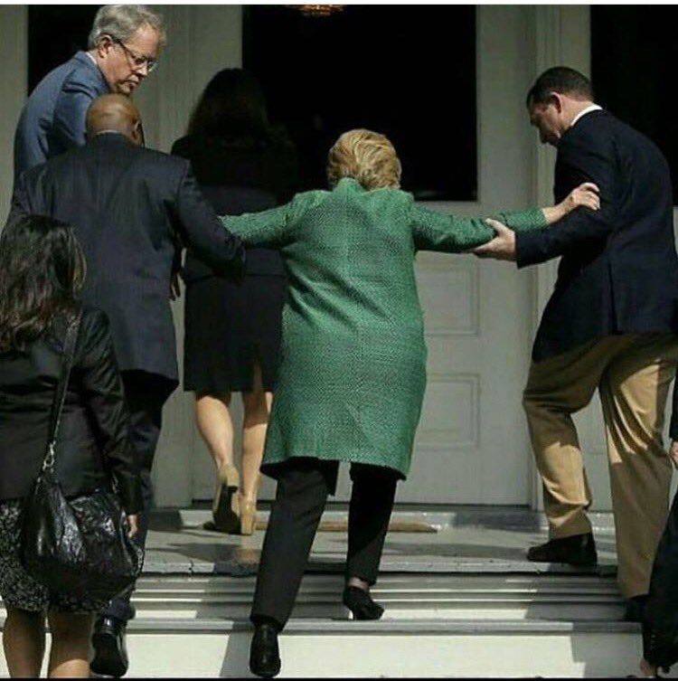 Hillary Clinton Helped Up Steps
